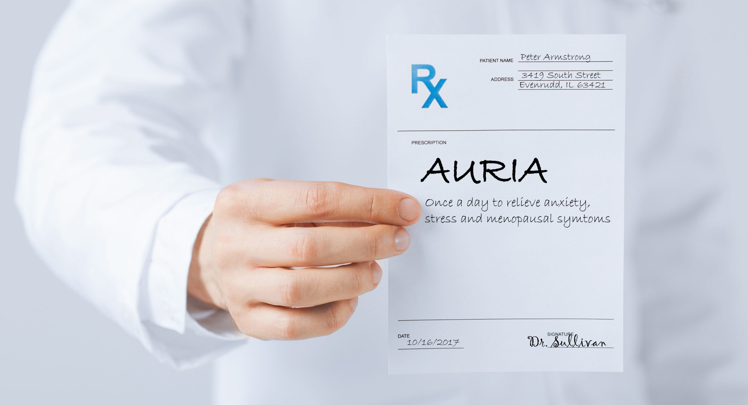 close up of male doctor holding rx paper in hand