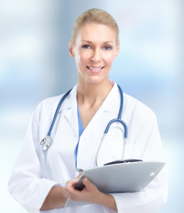 Beautiful smiling doctor woman over blue hospital background